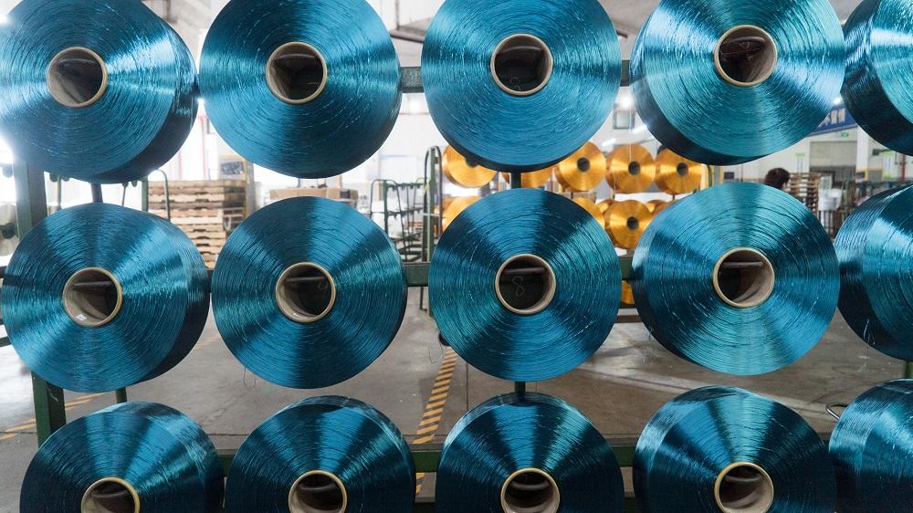 厂家永兴供应POY/DTY涤纶色丝150D/300D低弹网络色丝,涤纶低弹丝。