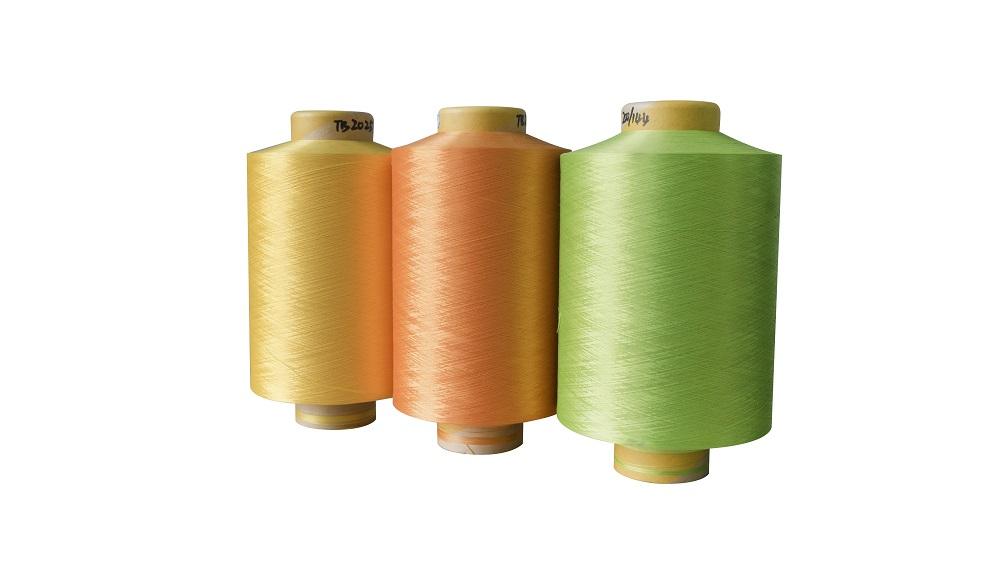 厂家环保POY/DTY涤纶色丝150D/300D低弹网络色丝,涤纶低弹丝。