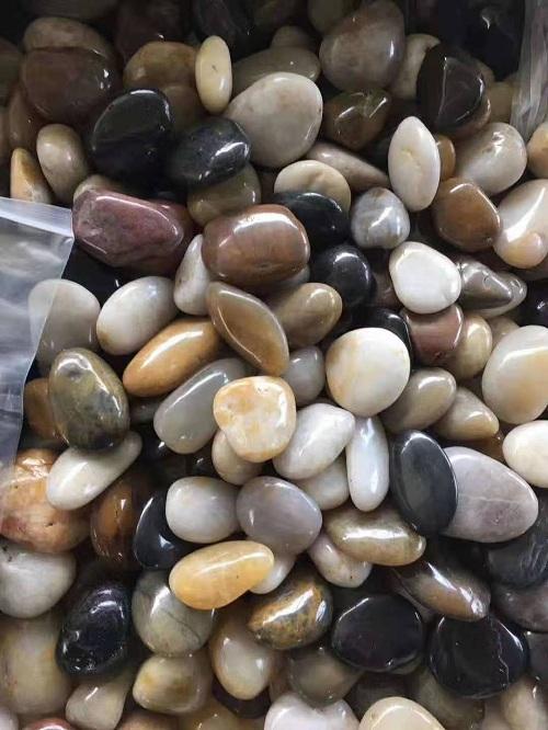 厂家直销 精品黑石 抛光雨花石 观景铺路石 鹅暖石毛料